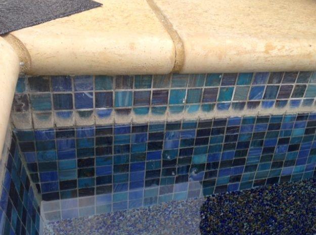 caclium silicate on pool tiles