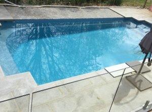 Salt staining on fibreglass pool - after